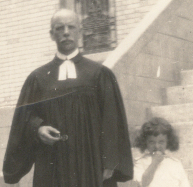 Reverend Garschow and Child on Church Steps