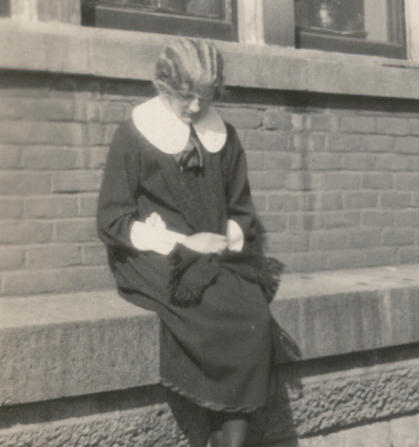 Woman Takes a Seat Outside of Dorms at Bethany Lutheran College
