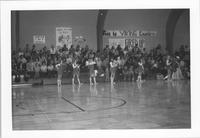 Bethany Lutheran College 1974-1975 snapshot of cheerleaders at a men's basketball game