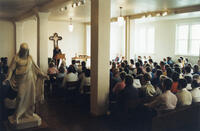 Snapshot of Glenn Reichwald preaching in the Old Main chapel at Bethany Lutheran College in the 1980s